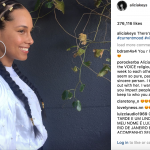 Alicia Keys Sports Braids Decorated with Gold Cuffs